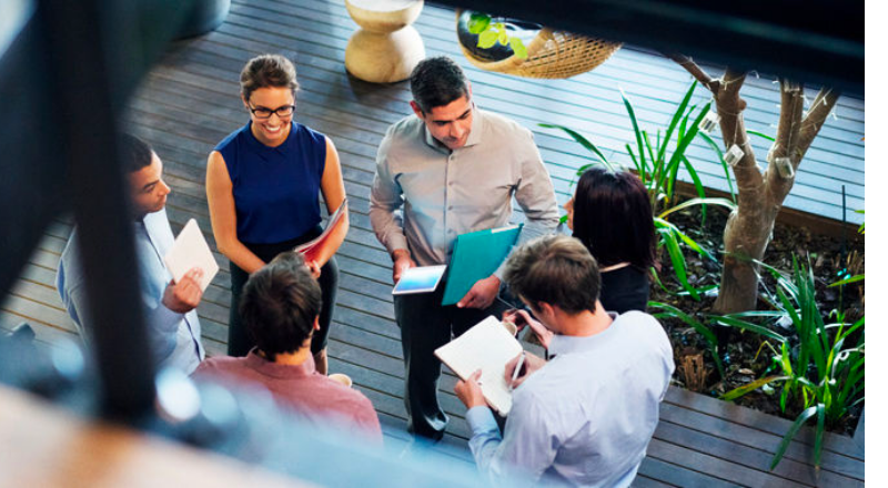 Businesspeople standing in a circle and talking