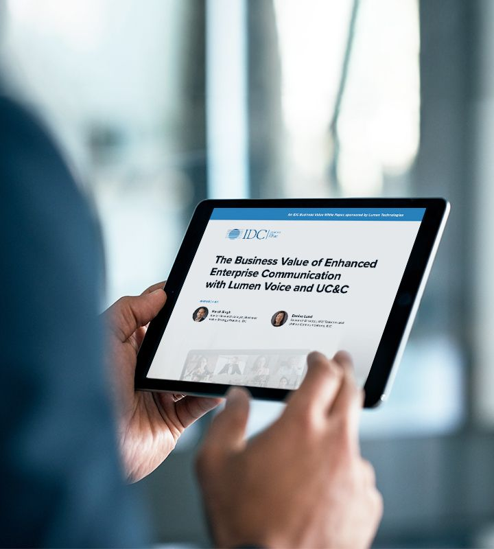 Businessperson reading IDC report on a tablet