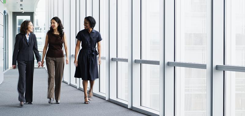 Women walking in corporate offices hallway